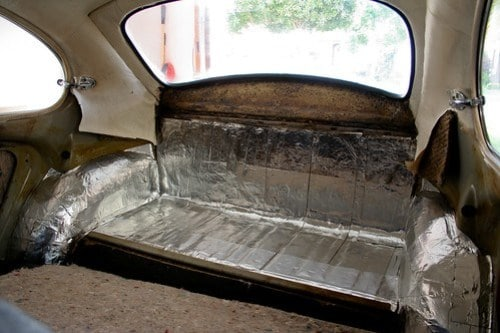Remove everything from the back compartment and add sound deadening insulation