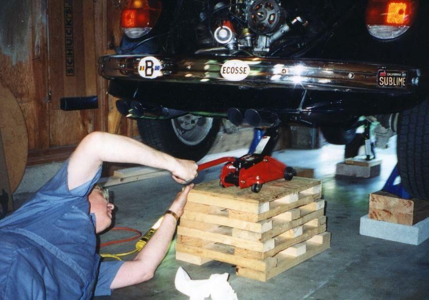 VW Beetle engine removal with jack pedestal.