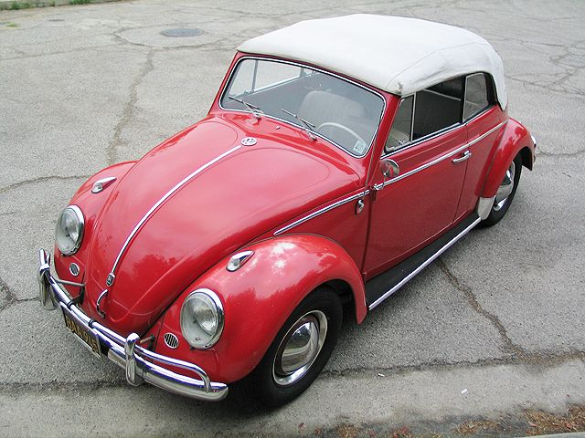 A red 1963 VW Beetle convertible.