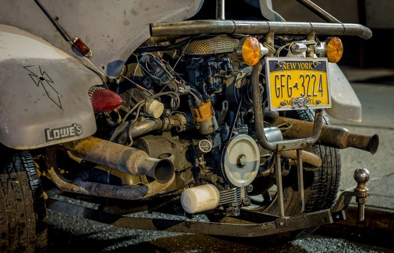 The VW Baja Bug engine is exposed.