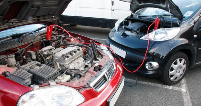 How to jump start a car with jumper cables.