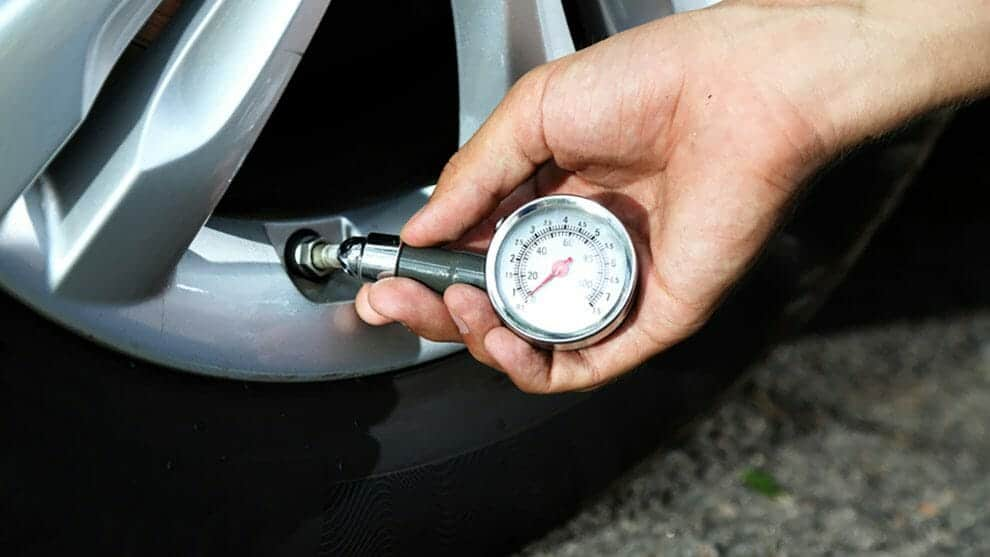 Check the pressure with a tire pressure gauge